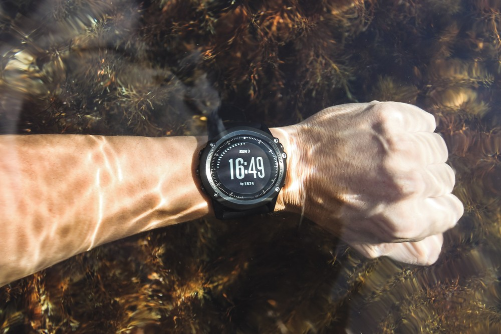 Waterproof sport watches underwater on hand