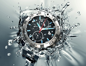 metal wristwatch is falling and splashing into clear water